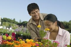 Couple Shopping at Plant Nursery smelling flowers Stock Photography