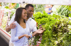 Couple shopping in produce department. Couple shopping in supermarket produce department Stock Photos