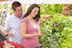Couple shopping in produce section. Couple shopping in supermarket produce section Royalty Free Stock Photography