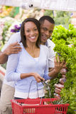 Couple shopping in produce section. Couple shopping in supermarket produce section Royalty Free Stock Image