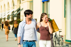 Couple shopping and spending money in city Stock Photo