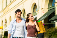 Couple shopping and spending money in city Royalty Free Stock Photo
