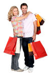 Couple on a shopping spree. Happy couple on a shopping spree stock images