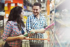 Couple shopping in store for food royalty free stock photo