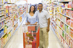 Couple shopping in supermarket. Couple shopping for groceries in supermarket Royalty Free Stock Image