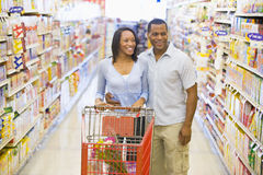 Couple shopping in supermarket. Grocery aisle Royalty Free Stock Photo