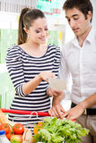 Couple shopping at supermarket Royalty Free Stock Photography