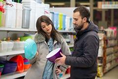 Couple Shopping At The Supermarket Stock Photo