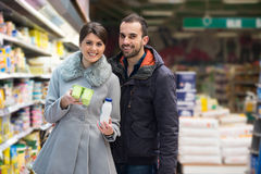 Couple Shopping In Supermarket Stock Photo