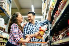 Couple shopping at supermarket Royalty Free Stock Photo