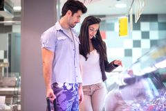 Couple shopping in a supermarket Stock Photo