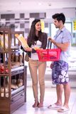 Couple shopping in a supermarket Stock Photography