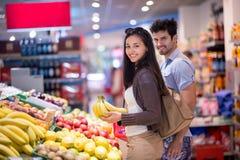 Couple shopping in a supermarket Stock Photos