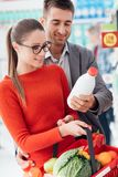 Couple shopping at the supermarket royalty free stock photos