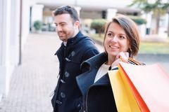 Couple in shopping time. Walking in the city street Stock Photo
