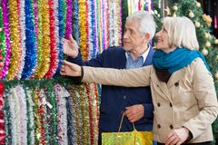 Couple Shopping For Tinsels At Store Stock Image