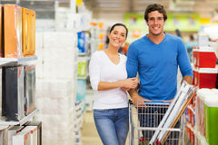 Couple shopping together. Portrait of couple shopping together at supermarket Royalty Free Stock Photography