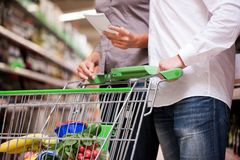 Couple Shopping Together at Supermarket Stock Photos