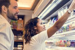 Couple shopping together at a supermarket royalty free stock photos