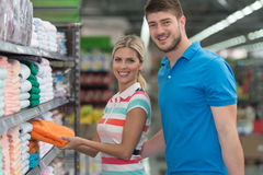 Couple Shopping Trolley. Beautiful Young Couple Shopping For Trolley In Produce Department Of A Grocery Store - Supermarket - Shallow Deep Of Field Royalty Free Stock Photography