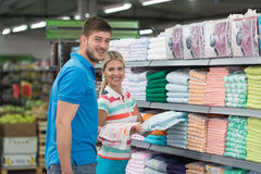 Couple Shopping Trolley. Beautiful Young Couple Shopping For Trolley In Produce Department Of A Grocery Store - Supermarket - Shallow Deep Of Field Stock Photography