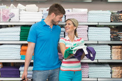 Couple Shopping Trolley. Beautiful Young Couple Shopping For Trolley In Produce Department Of A Grocery Store - Supermarket - Shallow Deep Of Field Royalty Free Stock Photo
