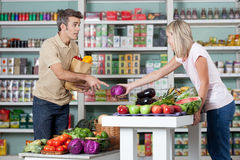Couple shopping a vegetables. Couple in love buying some vegetables Royalty Free Stock Photography