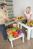 Couple shopping a vegetables Stock Photos