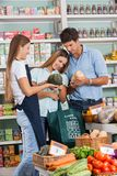 Couple Shopping Vegetables While Saleswoman Stock Photos