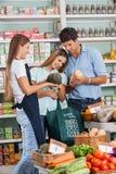 Couple Shopping Vegetables While Saleswoman Stock Photos