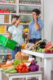 Couple Shopping Vegetables In Supermarket Royalty Free Stock Images