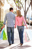 Couple shopping walking down the street Stock Image