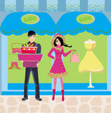 Couple on shopping - Winter SALES Royalty Free Stock Photos