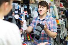 Couple shops at store buying socks Stock Image