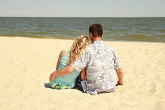 Couple  on the shore of the sea Stock Photo