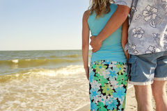 Couple  on the shore of the sea Royalty Free Stock Images