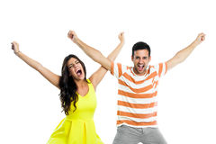 Couple shouting with arms raised. Royalty Free Stock Photo