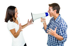 Couple shouting with man holding megaphone Stock Images