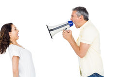 Couple shouting with man holding megaphone Stock Photography