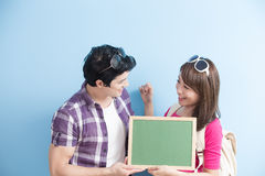 Couple show chalkboard Royalty Free Stock Photography