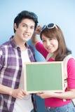 Couple show chalkboard Royalty Free Stock Photo