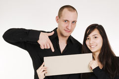 Couple show the sign Stock Image