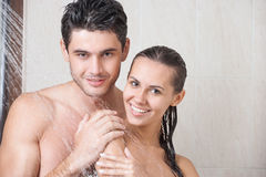 Couple in shower. Young couple washing their heads in the shower Royalty Free Stock Photos