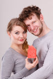 Couple showing affection with home symbol Royalty Free Stock Image