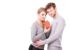 Couple showing affection with home symbol Stock Photos