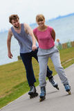 Couple showing affection during ride. Love romance leisure relax sport fitness concept. Couple showing affection during ride. Teen girl and boy on active date Royalty Free Stock Photography