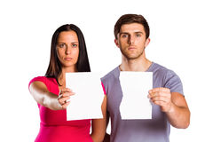 Couple showing broken piece of paper Stock Image