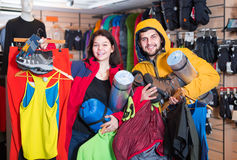 Couple showing clothes and things for tourism Stock Images