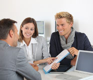 Couple showing good results to manager Royalty Free Stock Photos