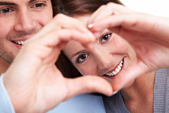Couple showing heart with fingers Royalty Free Stock Photo